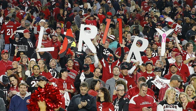 Arizona Cardinals fans cheer for Larry Fitzgerald  following the Cardinals  win over the  Green Bay Packers  in  their divisional playoff game Saturday, Jan. 16, 2016 in Glendale, AZ
