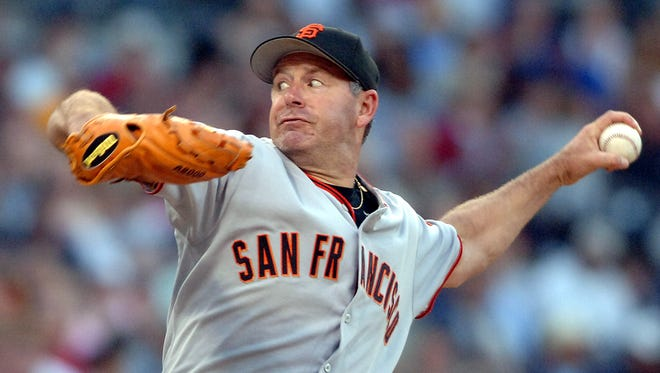 San Francisco Giants pitcher Jeff Fassero delivers a pitch during the second inning against the San Diego Padres Saturday, July 2, 2005 in San Diego. (AP Photo/Denis Poroy)