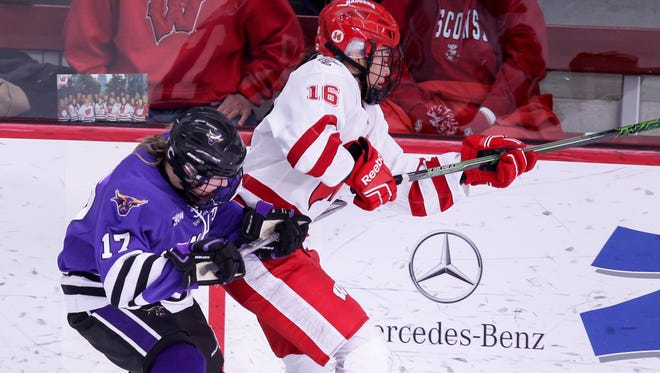 Wisconsin's Sarah Nurse, shown battling Minnesota State's Hannah Davidson in February in Madison, had four goals Sunday night in a 5-2 victory over North Dakota.