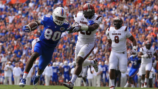 C'yontai Lewis #80 of the Florida Gators rushes for a touchdown during the first quarter of the game against the South Carolina Gamecocks at Ben Hill Griffin Stadium Saturday afternoon in Gainesville, Florida.