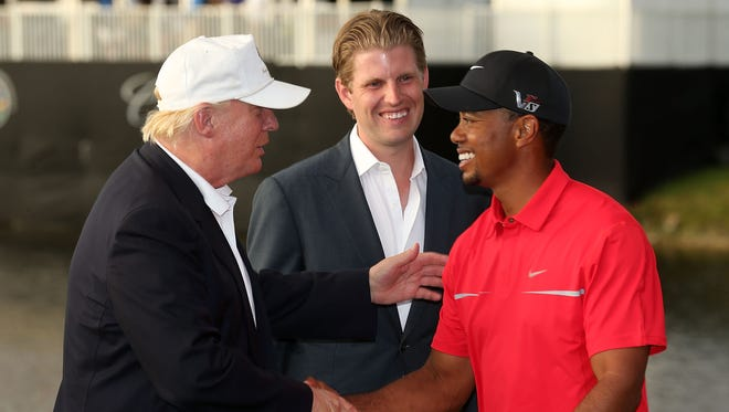 Donald Trump greets Tiger Woods after the final round of the World Golf Championships-Cadillac Championship in 2013.