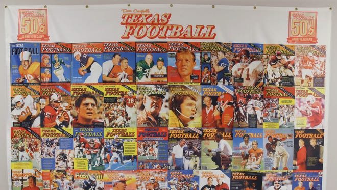 A banner commemorating 50 years of Dave Campbell's Texas Football magazine hangs in the office of Sports in Action in Carrollton, Texas. Magazines from the first edition of 1960 to the current edition of 2016 are housed here.
