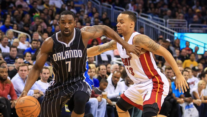 The Orlando Magic's Ben Gordon (7) drives past the Miami Heat's Shabazz Napier on Nov. 22, 2014.