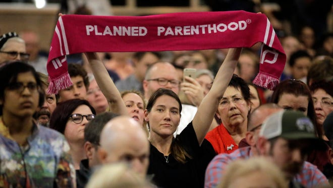 A Planned Parenthood supporter attends Rep. Jason Chaffetz's town hall meeting at Brighton High School in Cottonwood Heights, Utah, on Feb. 9, 2017.