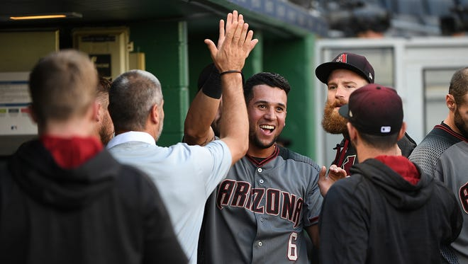 David Peralta #6 of the Arizona Diamondbacks is greeted by teammates in the dugout after scoring on an RBI single by Chris Owings in the 14th inning against the Pittsburgh Pirates at PNC Park on May 31, 2017 in Pittsburgh, Pennsylvania.