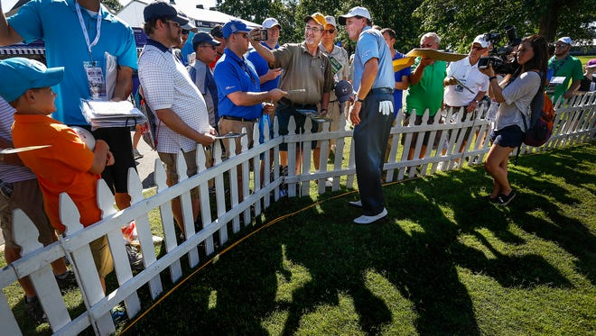 PGA golfer Phil Mickelson (middle right) takes pictures and signs autographs with fans after playing in the InnerWorkings Pro-Am at the FedEx St. Jude Classic at TPC Southwind on Wednesday morning.