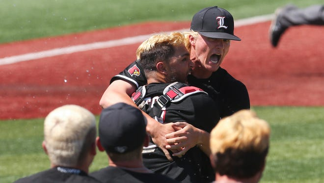 U of L's Sam Bordner (13) was embraced by catcher Colby Fitch (42) after they beat UK 6-2 in the super regional at Patterson Stadium.