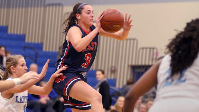 Brookfield East's Emma Ralfs leaps to pass the ball at Brookfield Central on Dec. 8.