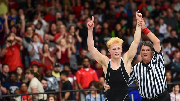 Liberty's Cole Murphy has his arms raised in triumph