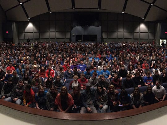 Oskaloosa High School students gather in an auditorium
