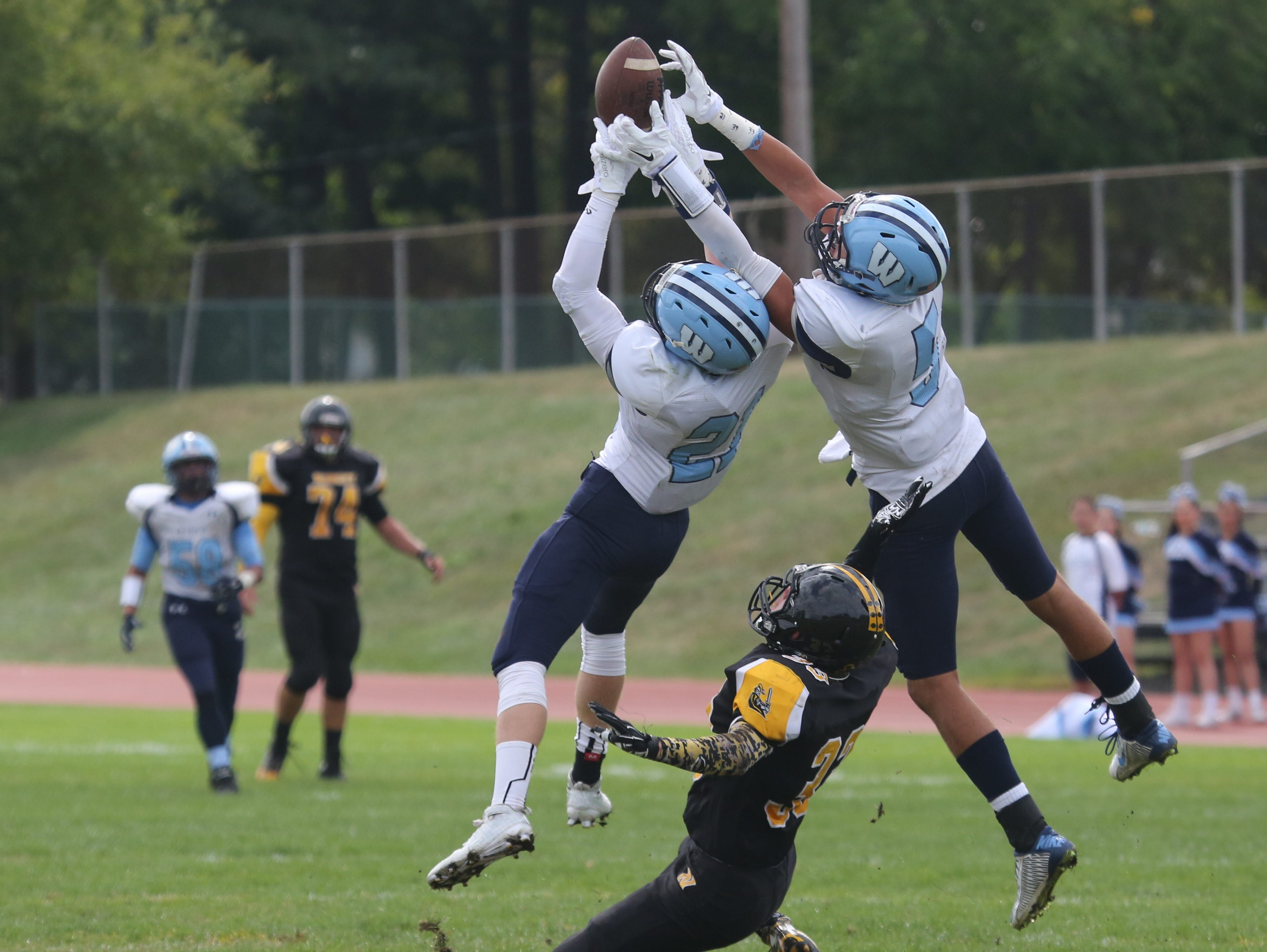 Westlake's Michael Love and William Snyder break up a pass intended for Nanuet's Brian McGreevy during action in the Nanuet vs. Westlake football game in Nanuet, Sept. 26, 2015.