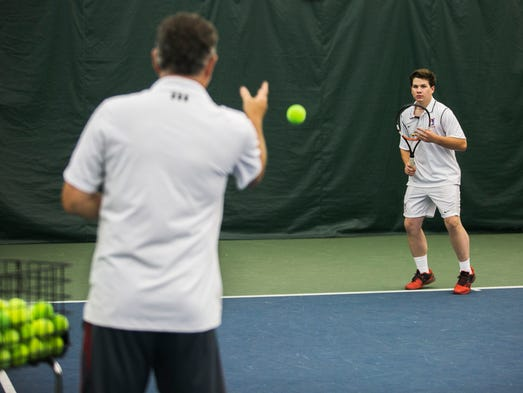 Edward Apple, 19, works on his forehand exercises with