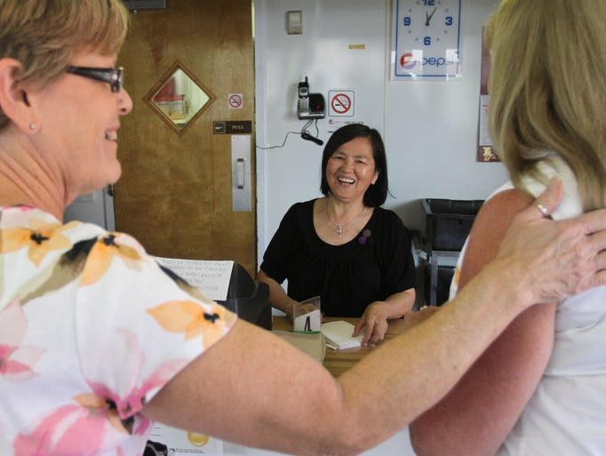 Mai Pong laughs with customers Debra Williams, left, and Gail Hamilton at Korea House on Tuesday, July 29, 2014. Williams and Hamilton joked that now that the restaurant is closing, they'll have to eat at Pong's house.
