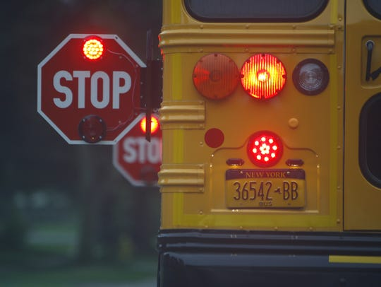 Motorists should watch out for school buses and stop
