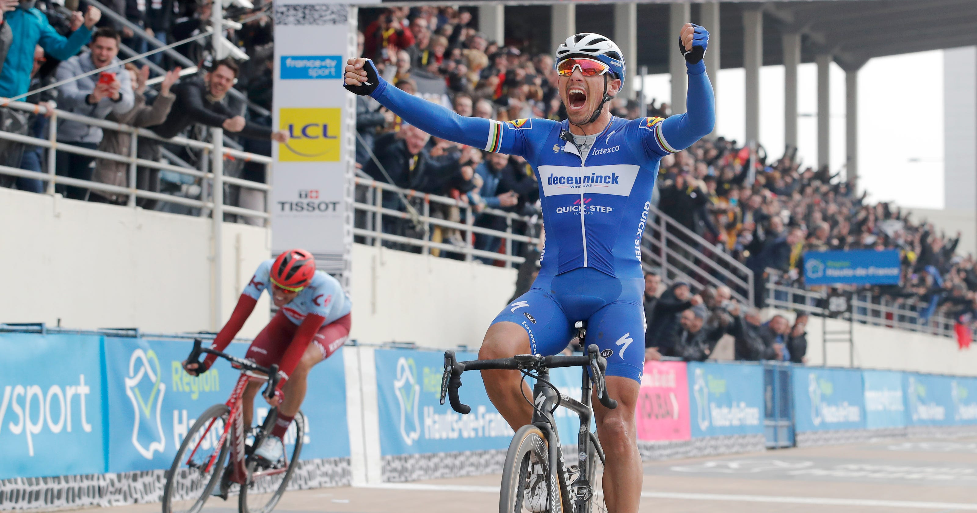 Belgian veteran Gilbert beats Politt to win Paris-Roubaix