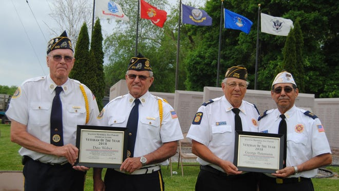 A special plaque was given to each Waupun veteran honored on Memorial Day. At left is American Legion Cmdr. Bob Patrouille, Dave Weber, George Baumann, and V.F.W. Cmdr. Frank Mesa.