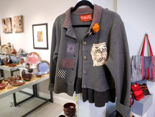 Women's jacket created with repurposed materials by