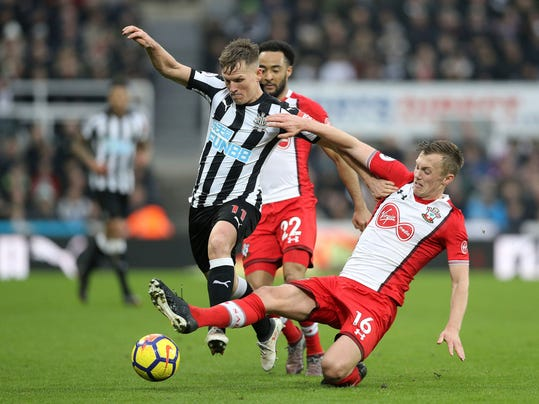Newcastle United's Matt Ritchie, left, clashes with Southampton's James Ward-Prowse during their English Premier League soccer match at St James' Park in Newcastle, Saturday March 10, 2018. (Owen Humphreys/PA via AP)