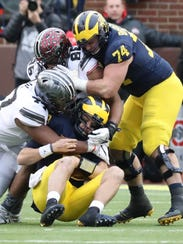 Nov. 25: Michigan's John O'Korn is sacked by Ohio State's