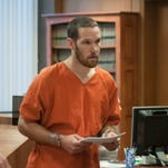 Nathan Donald Clark is escorted from his probable cause hearing Tuesday in District Judge Mike Hulewicz's courtroom.