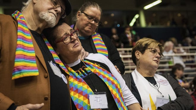 Ed Rowe, left, Rebecca Wilson, Robin Hager and Jill Zundel, react to the defeat of a proposal that would allow LGBT clergy and same-sex marriage within the United Methodist Church at the denomination's 2019 Special Session of the General Conference in St. Louis, Mo., Tuesday, Feb. 26, 2019.