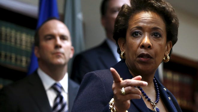 U.S. Attorney General Loretta Lynch speaks at a news conference at the U.S. Attorney's Office of the Eastern District of New York in Brooklyn May 27, 2015. U.S. authorities said nine soccer officials and five sports media and promotions executives face corruption charges involving more than $150 million in bribes.