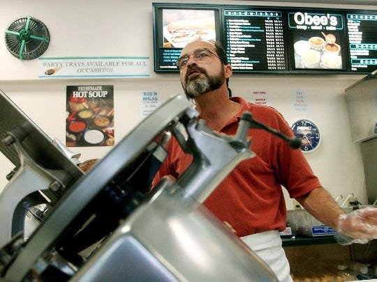 Lou Jerome, former owner of Obee's Soups, Salads and Subs, takes an order in this file photo from 2003.