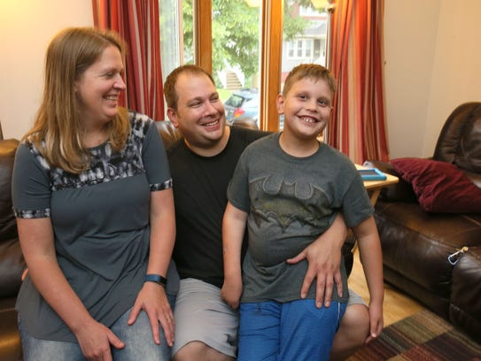 Kade Lubner age 9 (right) at home with his mother Liz