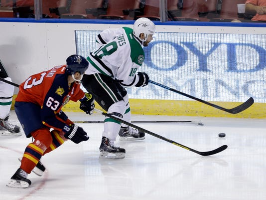 Dallas Stars right wing Patrick Eaves (18) drives as Florida Panthers center Dave Bolland (63) defends in the second period of an NHL hockey preseason game, in Sunrise, Fla., Wednesday, Sept. 24, 2014. (AP Photo/Alan Diaz)
