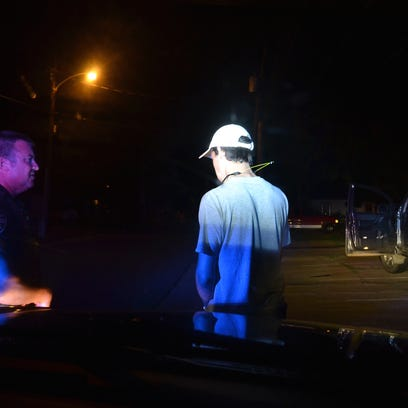Sgt. Bart Cavanaugh, traffic unit supervisor for the Bossier City Police Department, questions a motorist during a stop.