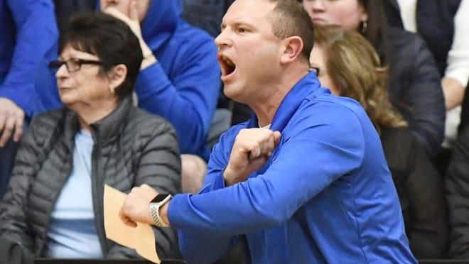 Mark Briggs, athletic director and boys basketball coach at Roxana High School.