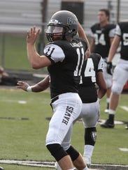 Quarterback Dylan Fry of Lakota East  returns for the