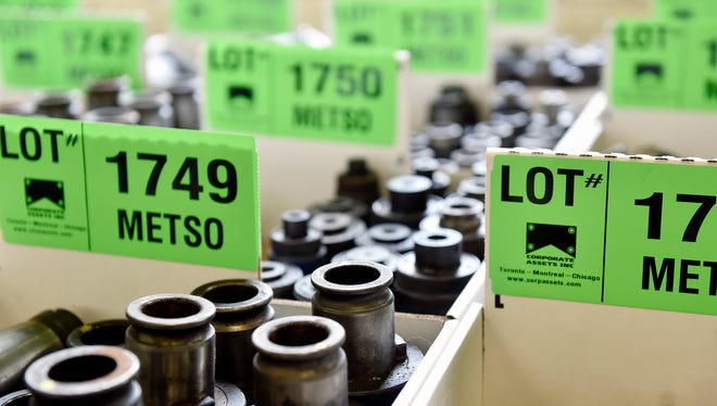 Boxes of machine components await auction at Metso's York manufacturing plant on June 22, 2016,. The company sold off the plant's equipment after the plant was closed.