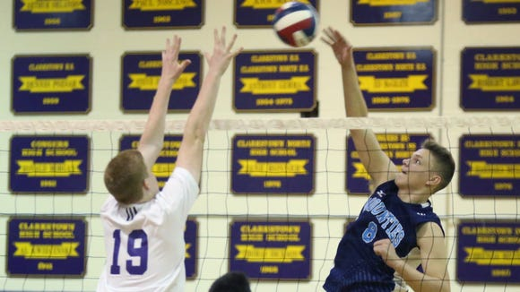Suffern's Dan Kenny (8) pushes a shot over Clarkstown