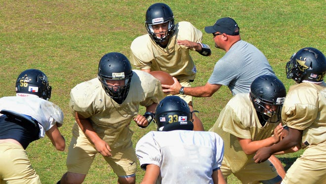 Haskell coach Brian Hodnett, runs the scout team offense during practice on Thursday, Oct. 5 in Haskell.