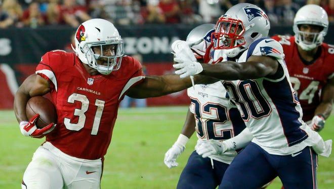 Arizona Cardinals running back David Johnson (31) runs the ball as New England Patriots free safety Duron Harmon (30) defends on Sunday, Sept. 11, 2016.