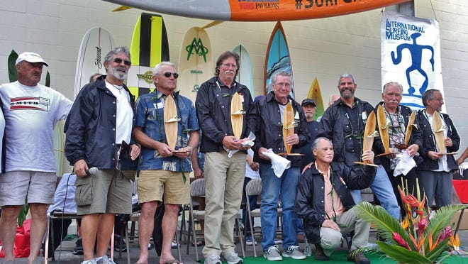 Greg Loehr, (center with khaki pants) was among seven surfboard craftsmen from around the globe who were honored for their contributions to the shaping industry at the annual International Surfboard Builders Hall of Fame ceremony held at Surf City USA's Huntington Beach, California, Surf Museum.