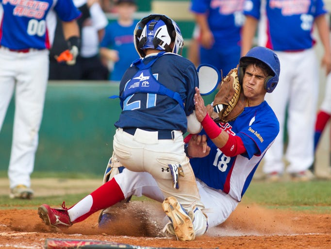 Los Gatos catcher Dallas Wilson tags out  Puerto Rico runner Jesus Rivera  at the plate during the Colt World series Wednesday, August 6, 2014, at Loeb Stadium in Lafayette. Los Gatos win  in extra inning 9-8.