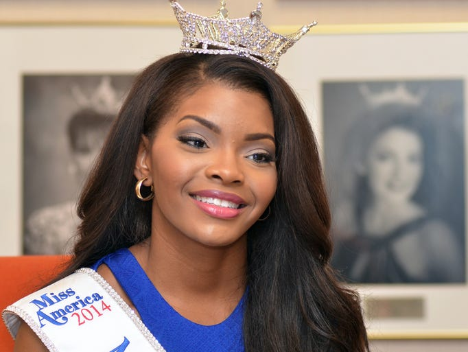Miss Mississippi 2014 Jasmine Murray, 22, of Columbus, handles media interviews with a smile on Sunday at the Miss Mississippi office in Vicksburg.