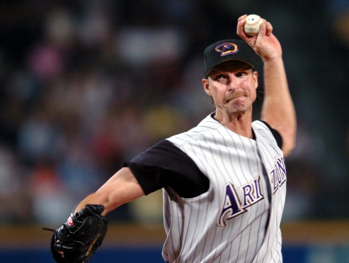 The Diamondbacks' Randy Johnson pitches during the upper 9th inning in a game against the Braves at Turner Field, May 18,2004.  Johnson pitches the perfect game.