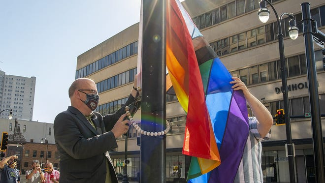 From left, U.S. Rep. James P. McGovern, D-Worcester, and Worcester Pride organizer Nathan Manna raise the Pride flag in front of Worcester City Hall Tuesday.