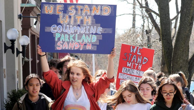 Viena Pentikainen, 17, and other Bronxville High School students in Bronxville, N.Y. students march through downtown Bronxville during a walk-out to protest gun violence and to commemorate the 19th anniversary of the shootings at Columbine High School April 20, 2018. About eighty students took part in the walk-out, which included a march to Christ Church in Bronxville where the students held a rally that included speakers and live music.