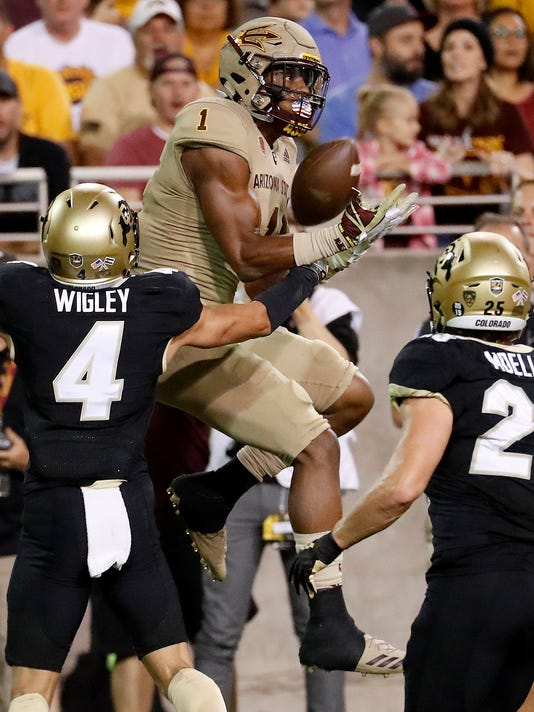 Arizona State wide receiver N'Keal Harry (1) pulls in a touchdown pass as Colorado defensive back Dante Wigley (4) defends during the first half of an NCAA college football game, Saturday, Nov. 4, 2017, in Tempe, Ariz. (AP Photo/Matt York)