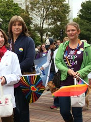 Christine Hallquist, center, marches in Burlington's Pride Parade on Church Street in September 2014, more than a year before Hallquist made a public transition to living as a woman.
