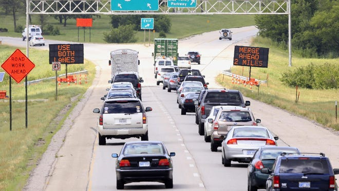 Drivers head north on U.S. 69 into a construction zone in Overland Park, Kan., Thursday, July 7, 2016. Kansas and Missouri departments of transportation hope to manage heavy construction seasons by persuading polite Midwesterners to do the zipper merge. Rather than merging as soon as it's safe, drivers will be asked to wait to merge as long as possible after reaching the construction zone for repairs.