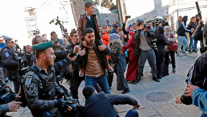 Israeli forces scuffle with people in Jerusalem's Old City on Dec. 8, 2017.