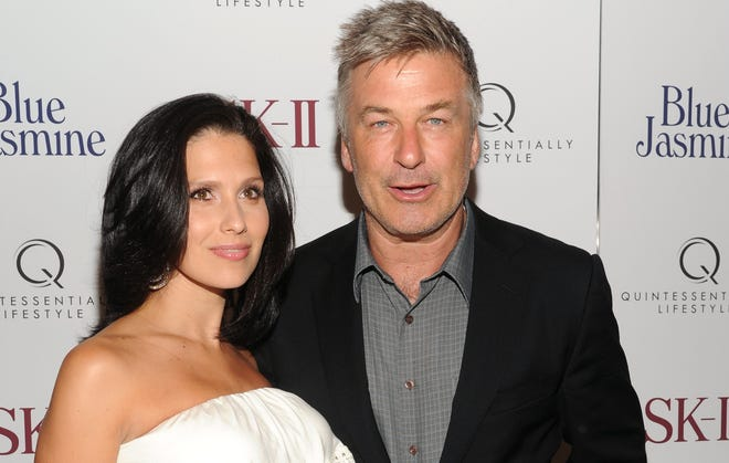 Actor Alec Baldwin and then-pregnant wife Hilaria in July 2013.
