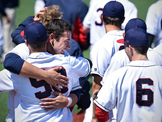 Patrick Strey  of St. John's celebrates with teammates  at the end of Saturday's MIAC conference championship game at Becker Park in Collegeville.