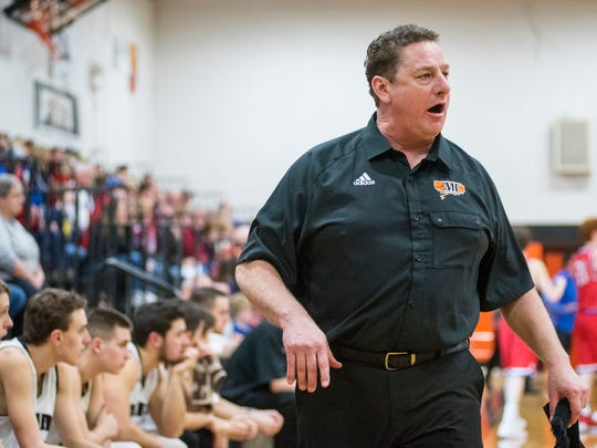 Marine City basketball coach Ron Glodich shouts to