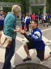 Wayne State police officer Collin Rose proposes to